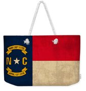 North Carolina State Flag Art On Worn Canvas Weekender Tote Bag by Design Turnpike