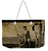 old sailor A vintage processed photo of a sailor sitted behind the rudder in Mediterranean sailing Weekender Tote Bag
