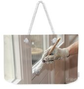 Paintbrush With White Paint In Hand Weekender Tote Bag