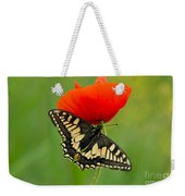 Papilio Machaon Butterfly Sitting On A Red Poppy Weekender Tote Bag