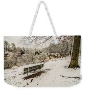 Park Bench In The Snow Covered Park Overlooking Lake Weekender Tote Bag