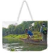 Poling A Dugout Canoe In The Rapti River In Chitwan National Park-nepal Weekender Tote Bag