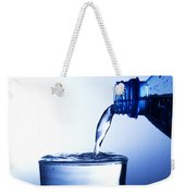 Pouring Fresh Water Into A Glass Weekender Tote Bag by Michal Bednarek