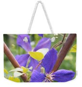 Purple Clematis Clinging On A Fence Weekender Tote Bag