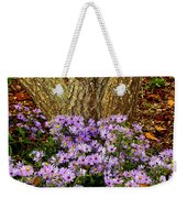 Purple Flowers At Base Of Tree Weekender Tote Bag