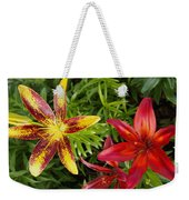 Red And Yellow Lilly Flowers In The Garden Weekender Tote Bag