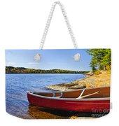 Red Canoe On Shore Weekender Tote Bag