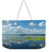 Scenic View Of A Lake Against Cloudy Weekender Tote Bag