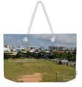 Schoolchildren Practicing On Playing Field With Singapore Skyline In Background Weekender Tote Bag