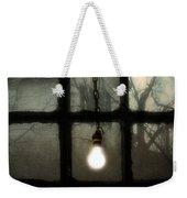 Lit Light Bulb Shines In Old Window Weekender Tote Bag