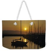Silhouetted Man On Sailboat Weekender Tote Bag