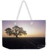 Silhouetted Tree In Field Sunrise Weekender Tote Bag
