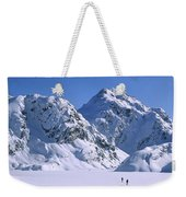 Skiers Cross Frozen Lake Harris Weekender Tote Bag