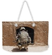 Soldier Searches A Compound Weekender Tote Bag by Stocktrek Images
