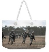 Soldiers Exit A Ch-47 Chinook Weekender Tote Bag