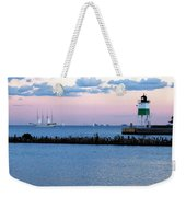 Southeast Guidewall Lighthouse At Sunset And Tall Ship Windy Weekender Tote Bag