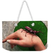 Stag Beetle On Hand Weekender Tote Bag by Daniel Eskridge