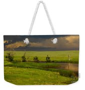 Storm Crossing Prairie 1 Weekender Tote Bag by Robert Frederick