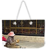 Street Shopkeeper In Lhasa-tibet Weekender Tote Bag