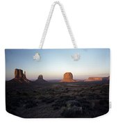 Sunset Light With Mittens And Desert In Monument Valley Arizona  Weekender Tote Bag