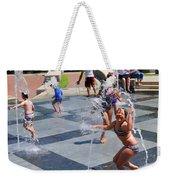 Joyful Young Girl Playing In Fountain Weekender Tote Bag