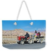 Tractor Towing A Wagon Along The Road To Shigatse-tibet Weekender Tote Bag