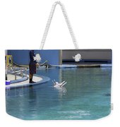 Trainer And Duo Of Dolphins At The Underwater World In Sentosa Weekender Tote Bag