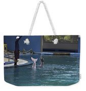 Trainer And The Tails Of A Duo Of Dolphins At The Underwater World Weekender Tote Bag