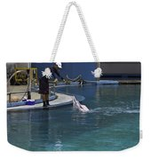 Trainer Feeding Duo Of Dolphins At The Underwater World In Sentosa Weekender Tote Bag