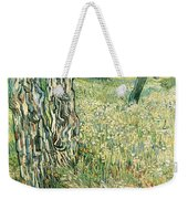 Tree Trunks In Grass Weekender Tote Bag