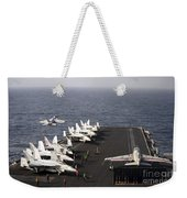 Uss Enterprise Conducts Flight Weekender Tote Bag by Stocktrek Images