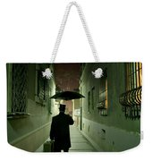 Victorian Man With Top Hat Carrying A Suitcase And Umbrella Walking In The Narrow Street At Night Weekender Tote Bag