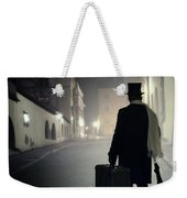 Victorian Man With Top Hat Carrying A Suitcase Walking In The Old Town At Night Weekender Tote Bag