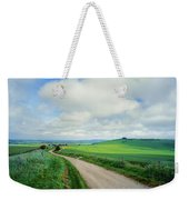 View Of Road Passing Through A Field Weekender Tote Bag