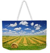 Wheat Farm Field And Hay Bales At Harvest In Saskatchewan Weekender Tote Bag
