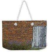White Door In Brick Building Weekender Tote Bag
