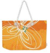 White Flower On Orange Weekender Tote Bag