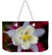White Flower On Red Background Weekender Tote Bag