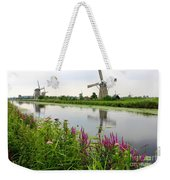 Windmills Of Kinderdijk With Wildflowers Weekender Tote Bag by Carol Groenen