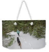 Woman And Dog Walking In Forest Weekender Tote Bag