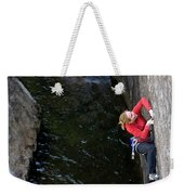 Woman Climbing Above A River Weekender Tote Bag