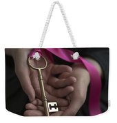 Woman Holding A Golden Key On A Pink Ribbon Weekender Tote Bag