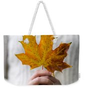 Woman Holding An Autumn Leaf Weekender Tote Bag