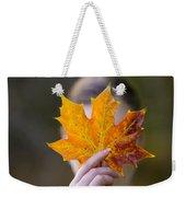 Woman Holding An Autumnal Leaf Weekender Tote Bag