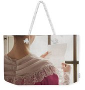 Woman In Historical Costume Reading A Letter By The Window Weekender Tote Bag