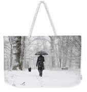 Woman Walking In A Snowy Forest Weekender Tote Bag