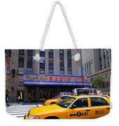 Yellow Cabs Pass In Front Of Radio City Music Hall Weekender Tote Bag