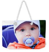 Young Baby Boy With A Dummy In His Mouth Outdoors Weekender Tote Bag