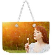 Young Beautiful Woman Blowing A Dandelion In Spring Scenery Weekender Tote Bag