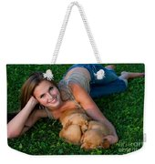 Young Woman And Golden Retriever Puppies Weekender Tote Bag